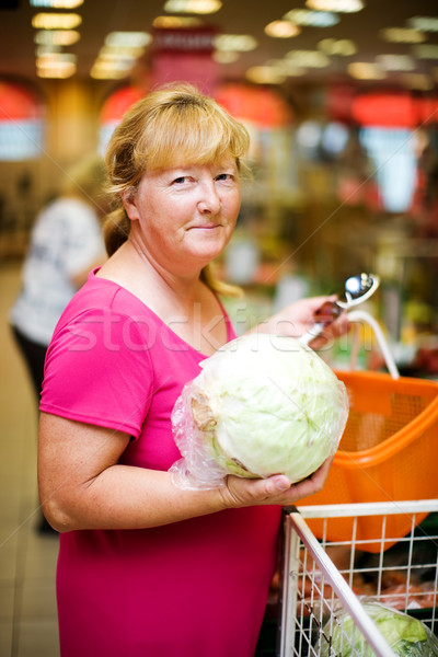 Housewife buying cabbage Stock photo © sapegina