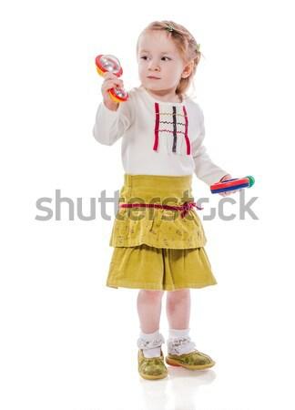 девушки играет греметь девочку игрушками Сток-фото © sapegina