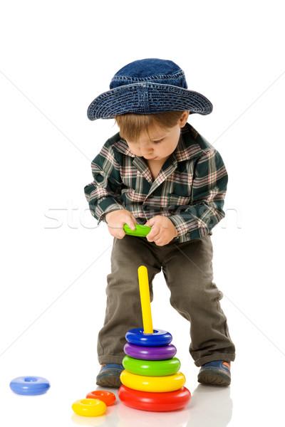 Fiú játszik színes piramis játék izolált Stock fotó © sapegina