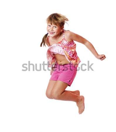 Atlama mutlu heyecanlı kız yalıtılmış Stok fotoğraf © sapegina