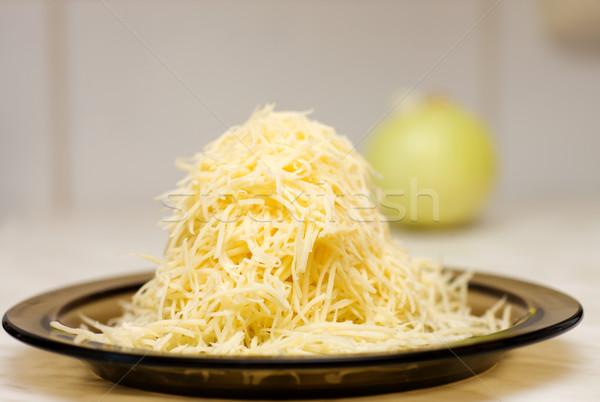 Formaggio grattugiato piatto tavolo da cucina formaggio giallo macro Foto d'archivio © sapegina