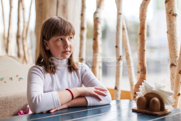 girl sitting at empty cafe Stock photo © sapegina