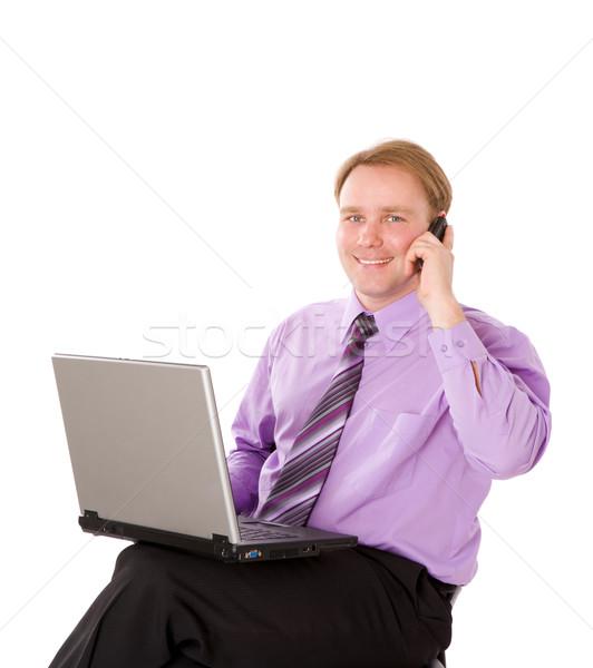 Işadamı konuşma cep telefonu dizüstü bilgisayar yalıtılmış Stok fotoğraf © sapegina