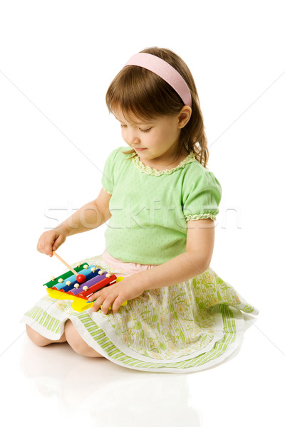 Girl playing on xylophone Stock photo © sapegina