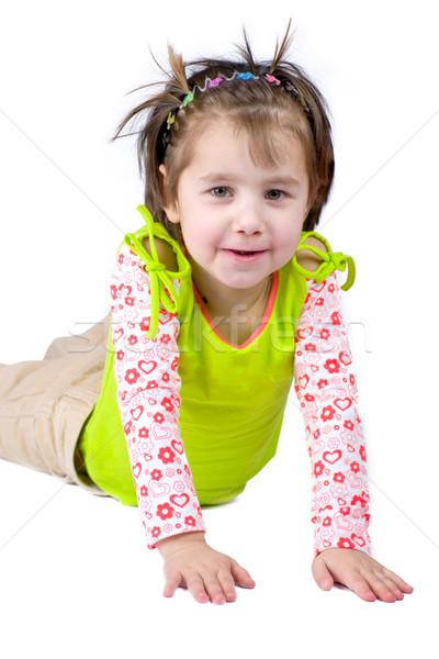 Dziewczyna funny twarzy pięć rok posiedzenia piętrze Zdjęcia stock © sapegina