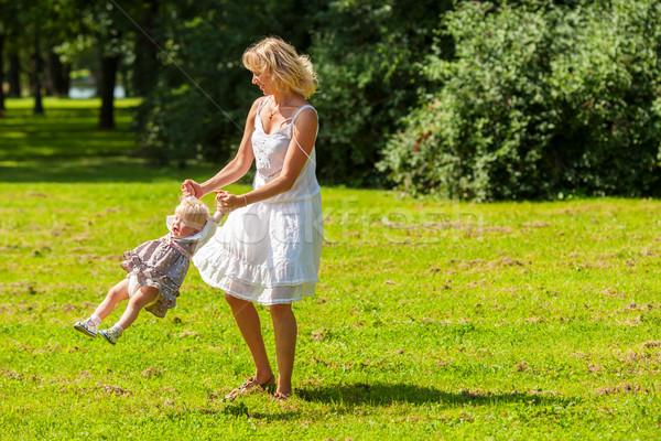 Happy mother spinning Stock photo © sapegina