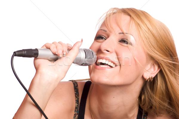 Menina cantando jovem belo loiro isolado Foto stock © sapegina
