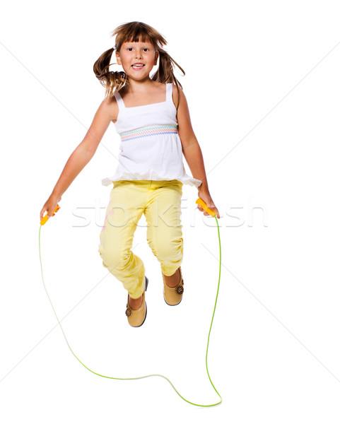 Lány ugrik hét évek kötél izolált Stock fotó © sapegina