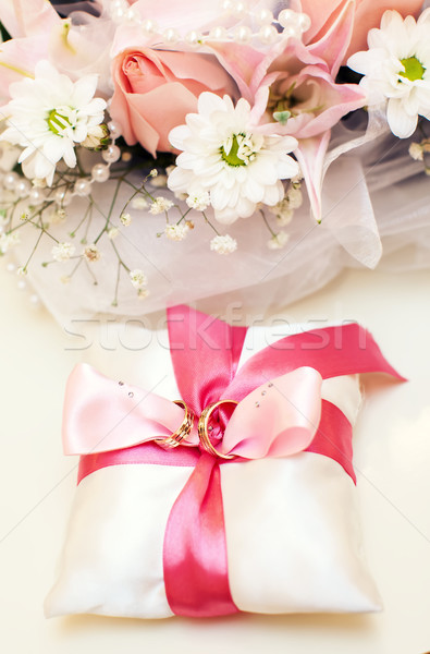 Wedding rings on satin pillow Stock photo © sapegina