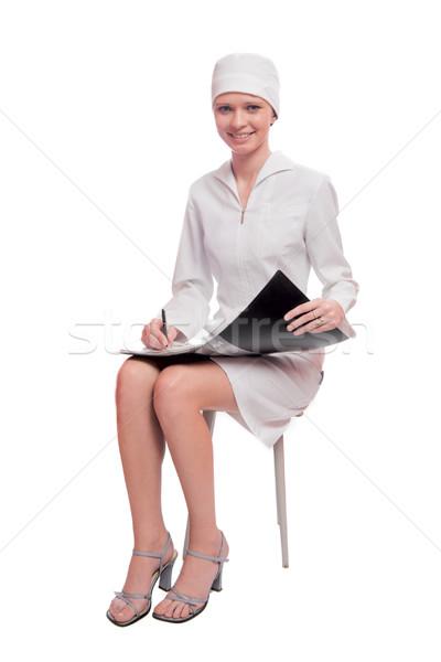 Orvostanhallgató ír lefelé izolált fehér nő Stock fotó © sapegina