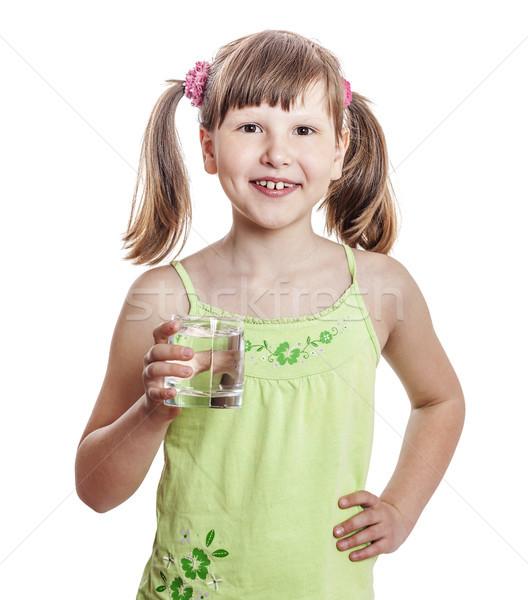 Menina água sorridente vidro isolado Foto stock © sapegina