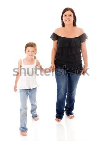 Anne kız poz birlikte yalıtılmış beyaz Stok fotoğraf © sapegina
