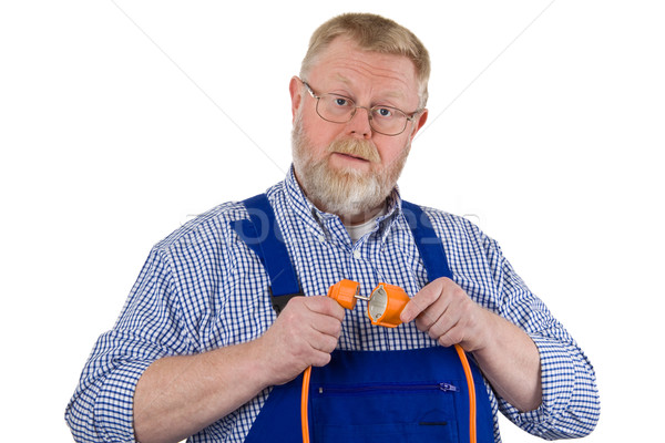 Electrician with extension cable Stock photo © Saphira
