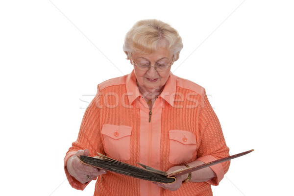 Senior woman with photo album Stock photo © Saphira