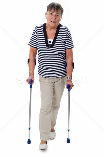Senior mulher muletas isolado branco saúde Foto stock © Saphira