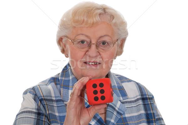 Senior vrouw dobbelstenen tonen Rood Stockfoto © Saphira
