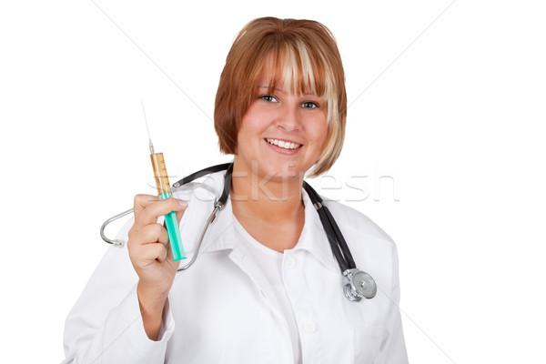 Oltás fiatal orvos injekció stúdió izolált Stock fotó © Saphira