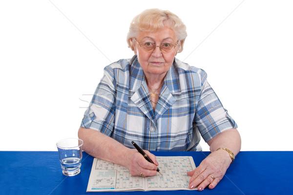 Kruiswoordraadsel puzzel portret ouderen vrouwelijke Stockfoto © Saphira