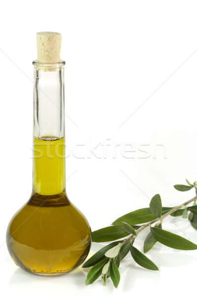 Bouteille huile d'olive supplémentaire olive branche Photo stock © Saphira