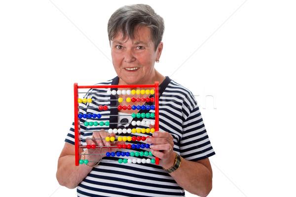 Senior woman calculating with abacus Stock photo © Saphira