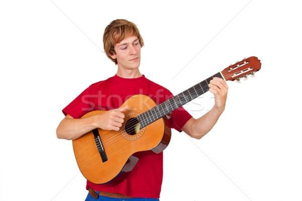 Adam oynama gitar genç yalıtılmış beyaz Stok fotoğraf © Saphira