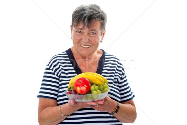 Senior vrouw vruchten plaat glimlach Stockfoto © Saphira