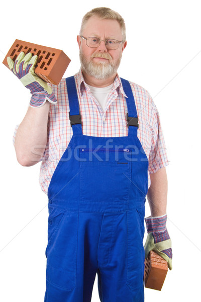 каменщик синий кирпича рук изолированный Сток-фото © Saphira