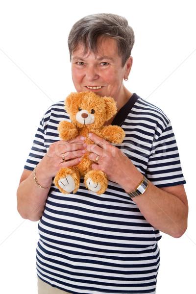 Senior mulher teddy ursinho de pelúcia sorrir idoso Foto stock © Saphira