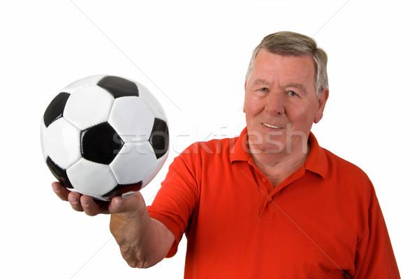 Stok fotoğraf: Yaşlı · adam · futbol · topu · kırmızı · siyah · beyaz · yalıtılmış