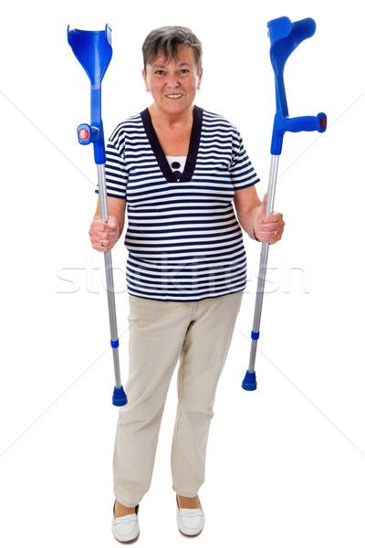 Krukken senior vrouw geïsoleerd witte Stockfoto © Saphira