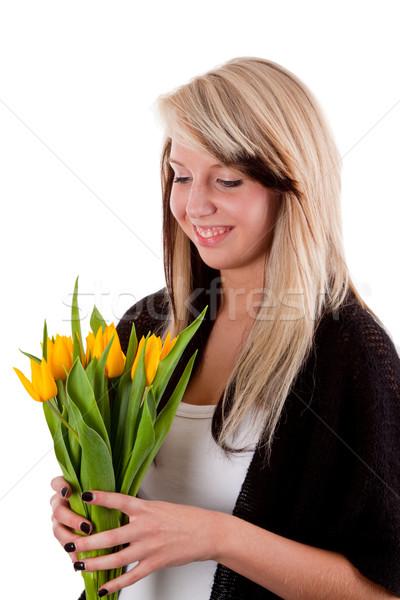 Fleurs du printemps jeune femme jaune tulipes isolé blanche Photo stock © Saphira