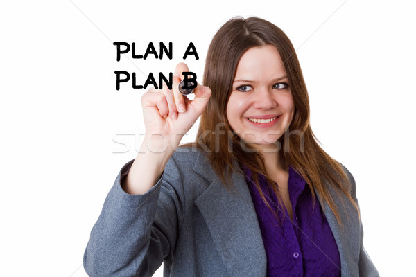 Young woman writing a plan Stock photo © Saphira