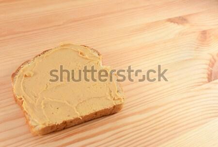 Pindakaas plakje brood exemplaar ruimte houten tafel voedsel Stockfoto © sarahdoow