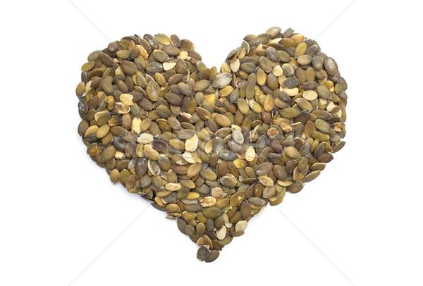 Foto stock: Calabaza · semillas · forma · de · corazón · aislado · blanco · corazón