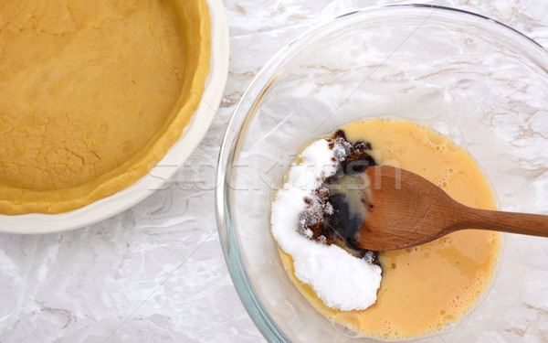 Stirring sugar into beaten egg for pumpkin pie filling Stock photo © sarahdoow