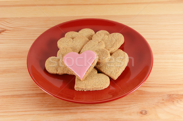 Iced and plain heart-shaped biscuits piled on a red plate  Stock photo © sarahdoow