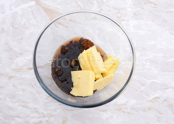Maple syrup, butter and dark soft sugar in a glass bowl Stock photo © sarahdoow
