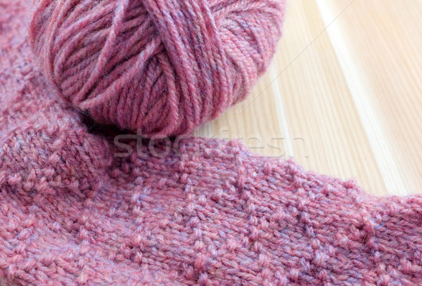 Stock photo: Patterned knitting with ball of pink yarn