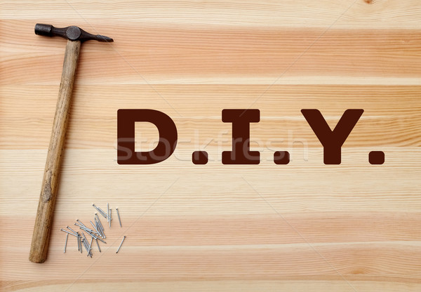 Hammer and panel pins - DIY text written on wood Stock photo © sarahdoow