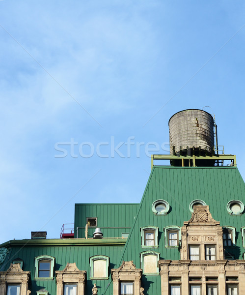 Water tower on the rooftop of a New York building Stock photo © sarahdoow