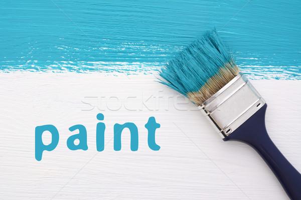 Raya turquesa pintura pincel palabra blanco Foto stock © sarahdoow