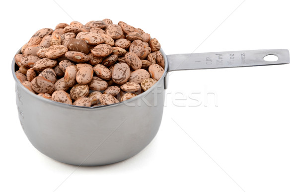 Pinto beans in an American cup measure Stock photo © sarahdoow