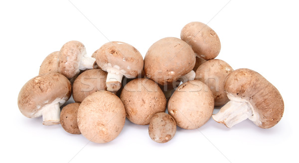 Heap of chestnut mushrooms showing caps and stalks Stock photo © sarahdoow