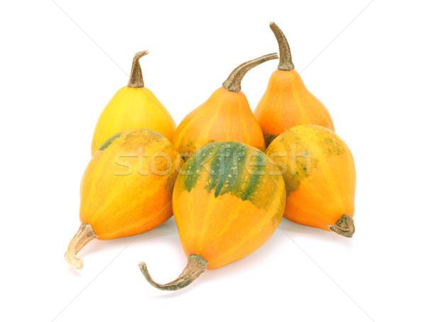 Group of six orange pear bicolor ornamental gourds Stock photo © sarahdoow