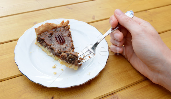 Woman holding a bite of pecan pie on her fork Stock photo © sarahdoow