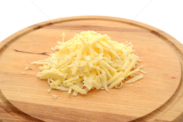Stock photo: Grated cheese on a wooden board