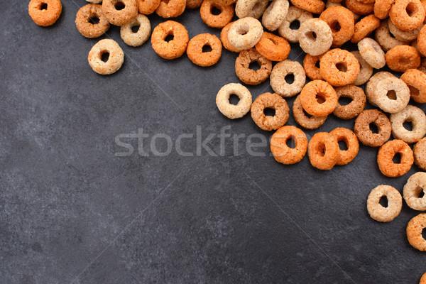 Multigrain hoops breakfast cereal diagonal border on grey slate Stock photo © sarahdoow