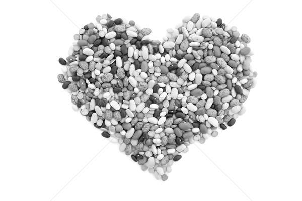 Karışık kurutulmuş fasulye kalp şekli yalıtılmış beyaz Stok fotoğraf © sarahdoow