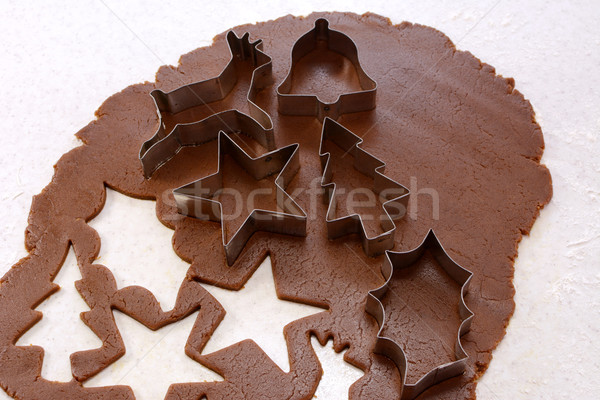 Cookie cutters and shapes in gingerbread dough Stock photo © sarahdoow