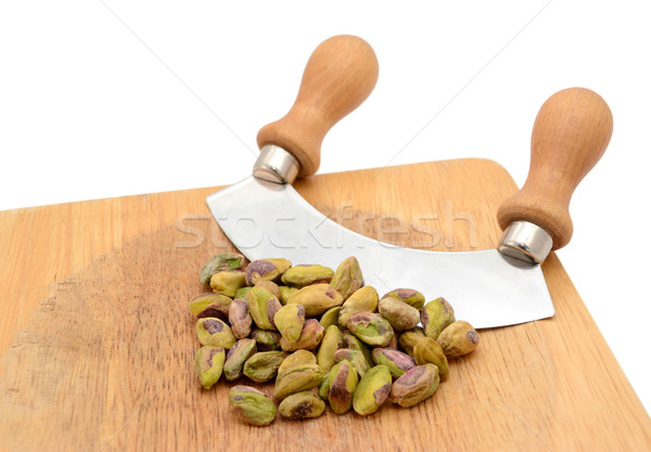 Whole pistachios with a rocking knife Stock photo © sarahdoow